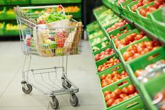 Trolley in grocery store Stock Photos