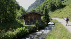 Barn and forest and wild stream at Zillertal valley Schwarzachtal (Austria) Stock Footage