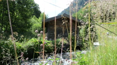 Small barn at wild stream at Zillertal valley Schwarzachtal Stock Footage