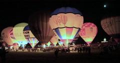 Hot air baloons glowing at night Stock Footage