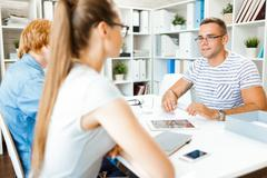 Young employer interviewing specialists in office Stock Photos