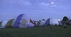 Hot air baloons being prepared for take off Stock Footage