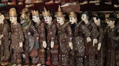 Traditional handicraft puppets are sold in a market in Mandalay, Myanmar . Burma Stock Footage