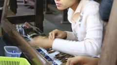 Textile manufacture in craft village where women work in fabric, Myanmar. Burma Stock Footage