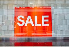 Red signboard announcing big sale - stock photo
