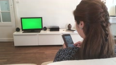 Dolly Shot Young Woman With Smartphone TV Green Screen Stock Footage