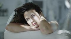 Beautiful brunette model wearing lingerie relaxing in her boudoir. Stock Footage