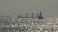 4K sailing ship frigate and ferry in the sea crossing paths,long shot Stock Footage