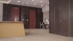 Business People Running in Office Stock Footage