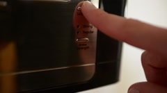 Finger Pressing Buttons on Coffee Maker Stock Footage