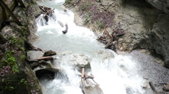 Hiking through the Wolfsklamm gorge on stairs in european alps. Stock Footage