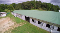 Large metal roof barn jib shot Stock Footage