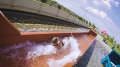 Free falling on extreme water slide in slow motion Stock Footage