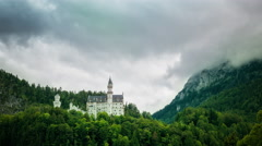 Famous Neuschwanstein Castle landmark attraction cloudy sky fairytale mountain Stock Footage