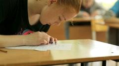 Russia, Novosibirsk, 2015: School girl at a school desk Stock Footage