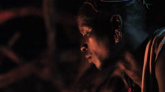 Close Up of An Omo Valley Tribe Member Sitting By Fire Stock Footage