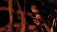 Close Up of An Ethiopian Tribal Man Sitting by A Fire Stock Footage