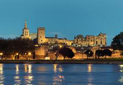 Avignon skyline. Riverside view of The Papal Palace at night. France Stock Photos