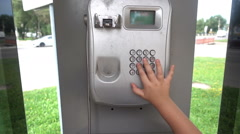 Payphone. Close-up of a children's hand taking an outdoor payphone Stock Footage