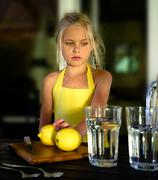 Beautiful girl in a yellow dress, lemon, lemonade Stock Photos