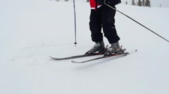 Happy skier on the slope at a ski resort in the mountains in slowmotion Stock Footage