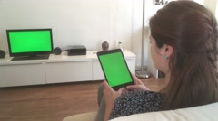Girl Watching Tablet TV Green Screen, Dolly Shot Arkistovideo