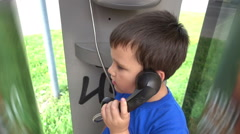 Payphone. Closeup of a baby talking on the payphone Stock Footage