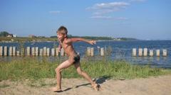 Child running on beach sand Stock Footage