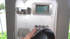 Payphone. Close up of a hand taking an outdoor pay phone Stock Footage
