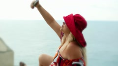 Romantic cute lady happy female tourist on vacation makes selfie near the sea Stock Footage