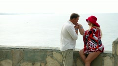 Happy romantic married couple in love - man and woman tourists vacationers  Arkistovideo