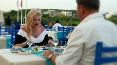 Happy married couple - man and woman in a restaurant at a resort seashore  Arkistovideo