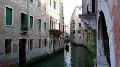 Venice with gondola in narrow canal Stock Footage
