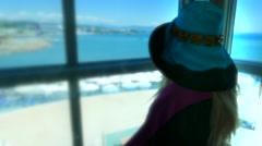 Lady tourist woman female in the glass elevator on the sea beach Stock Footage