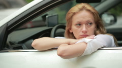 girl sitting in the car in the rain. the driver waits for passengers - stock footage