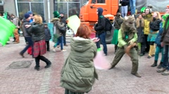 St. Patrick's day in Moscow, dance with the green - orange flags, the suit rats Stock Footage