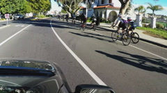 Large Group Of Bicyclists Riding In Bike Lane- Carlsbad California Stock Footage