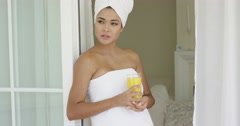 Gorgeous woman wrapped in towel Stock Footage
