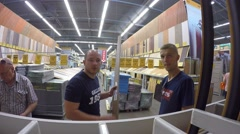 Male Customers Shopping at Building Supplies Store Stock Footage