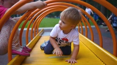 Children play on the Playground Stock Footage
