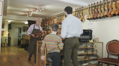 4K Father and son shopping together, make a purchase in a musical store Stock Footage