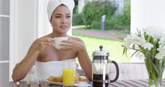 Grinning woman at breakfast table outdoors Stock Footage