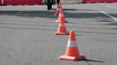 Exercise with cones on the motorbike on the skill training asphalt motordrome Stock Footage