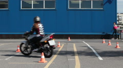 Advanced rider training for motorcycle skills. Woman trains Stock Footage
