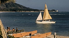 Hawaii 1962: sail passing in front of the beach Stock Footage