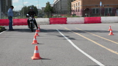 Learner motorcyclist  drives on skill training in motordrome Stock Footage