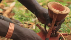 Close Up of An Omo Valley Tribe Member Using Traditional Methods of Carving Stock Footage