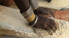 Close Up of An Omo Valley Tribe Member Making Flour Using Traditional Methods Stock Footage