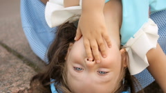 Portrait of a little girl three years with the blue bow on her head which is Stock Footage