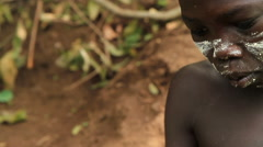 Close Up of A Boy From An Omo Valley Tribe Working With Traditional Methods Stock Footage